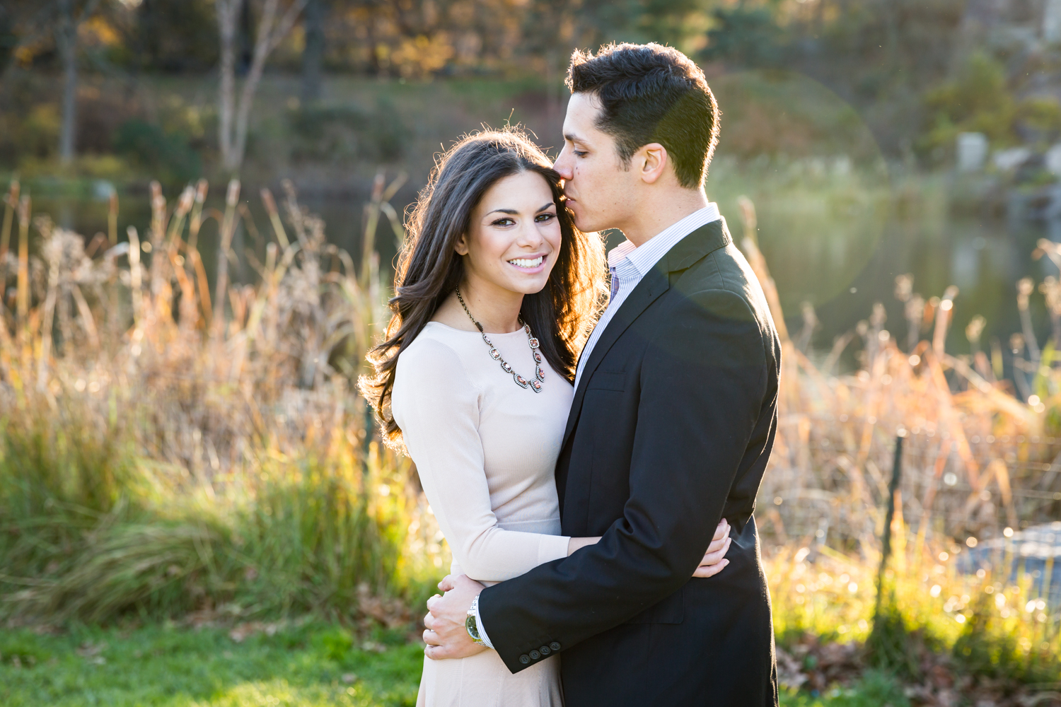 Central Park save-the-date photos of couple with fall foliage in background