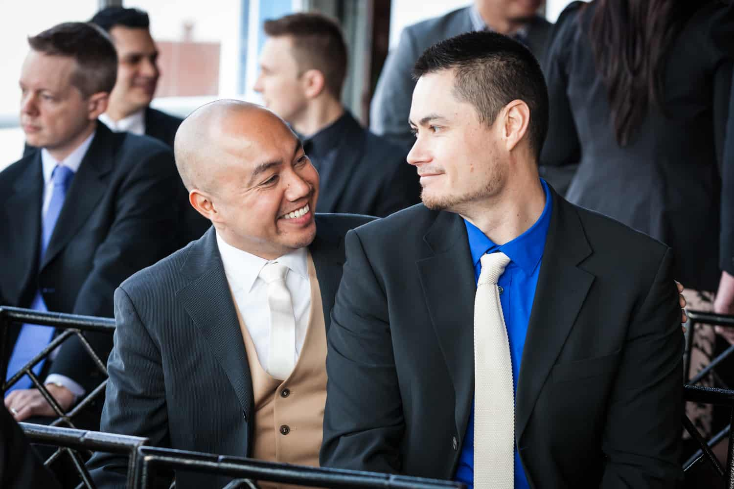 Two male guests before ceremony at a Lighthouse at Chelsea Piers wedding