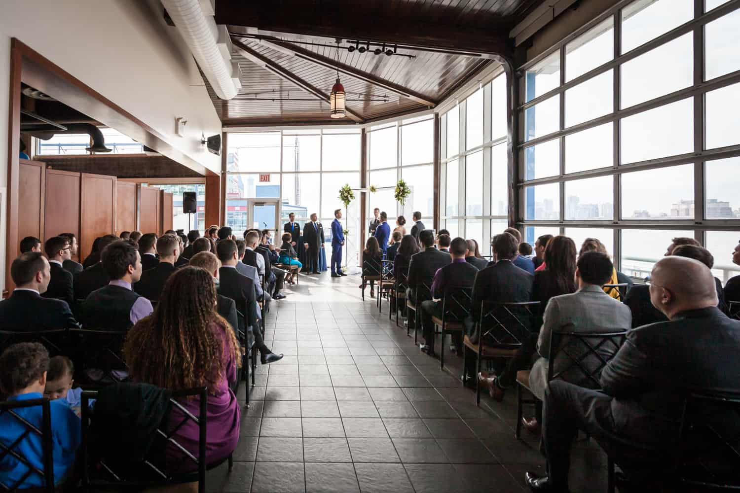 Wide shot of ceremony at a Lighthouse at Chelsea Piers wedding