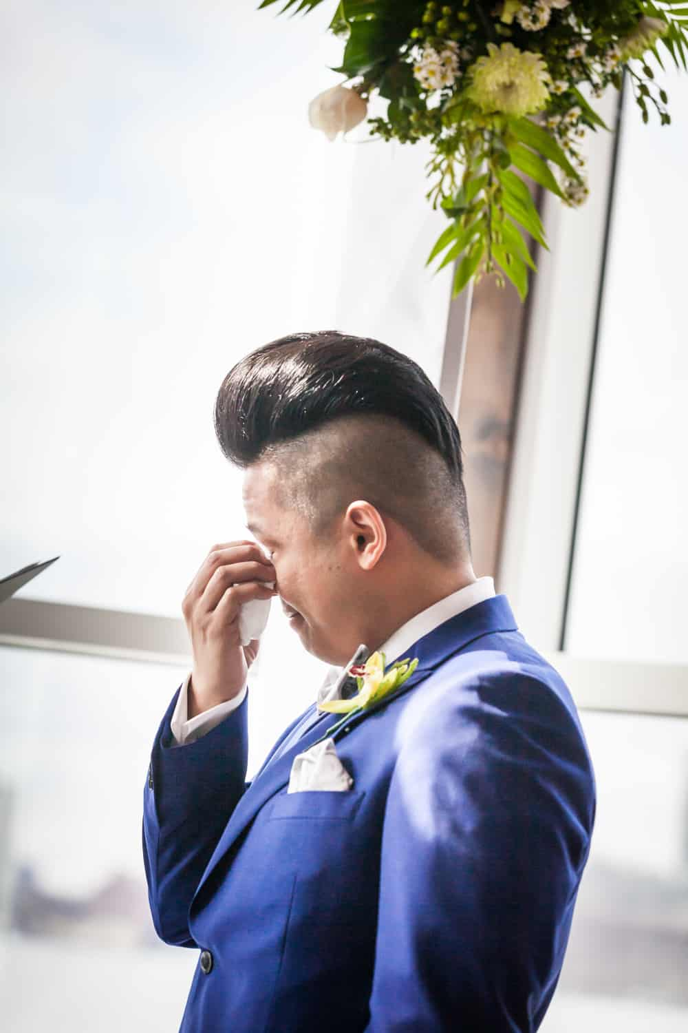 Groom wiping away tear at a Lighthouse at Chelsea Piers wedding