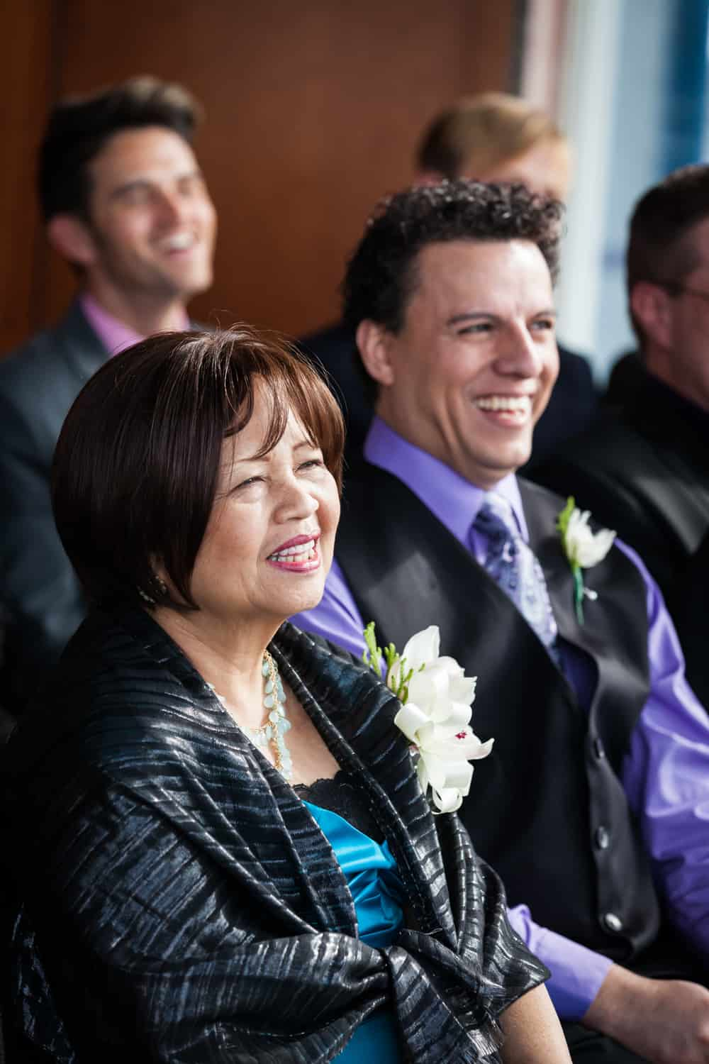 Groom's mother and best man watching ceremony at a Lighthouse at Chelsea Piers wedding