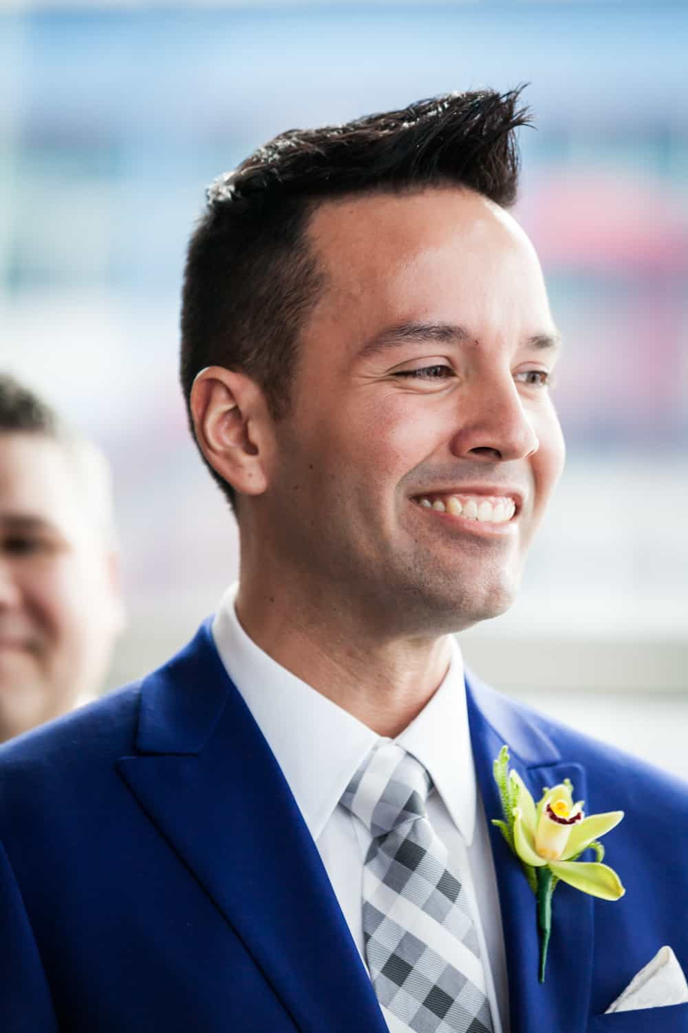 Groom smiling during ceremony at a Lighthouse at Chelsea Piers wedding