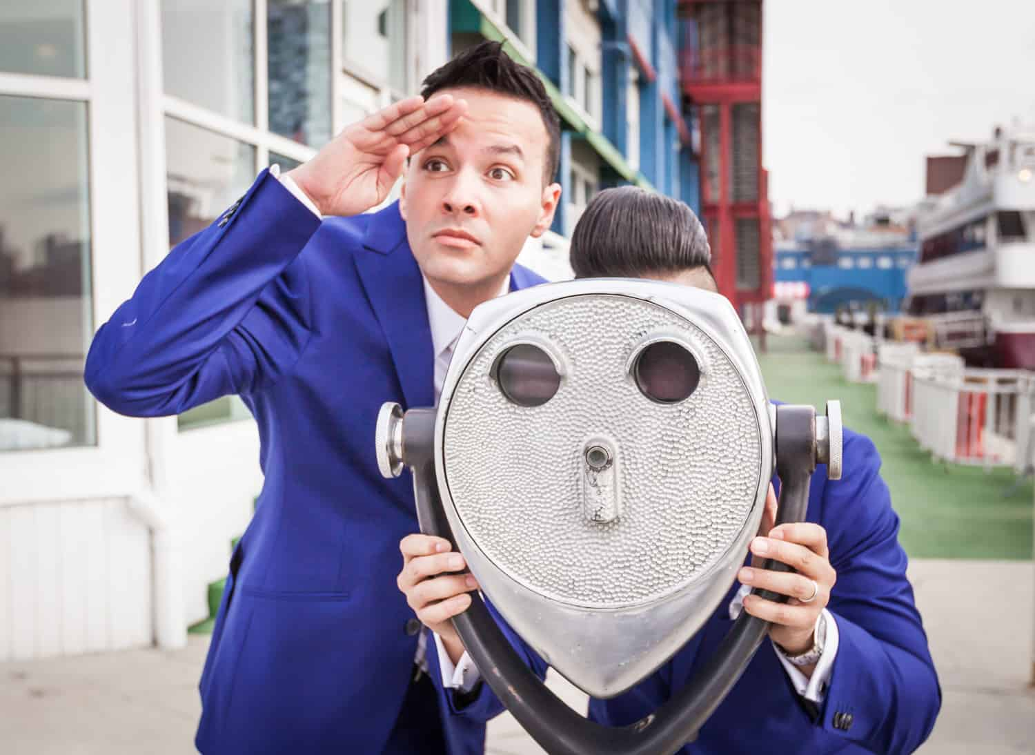 Two grooms playing with view master at Chelsea Piers