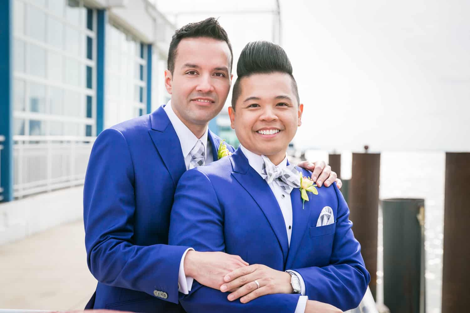Two grooms beside Hudson River waterfront