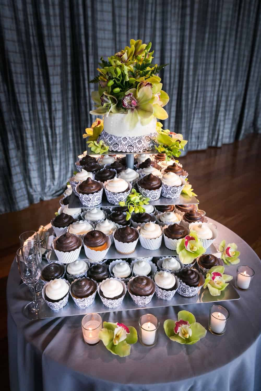 Tier of cupcakes with orchids