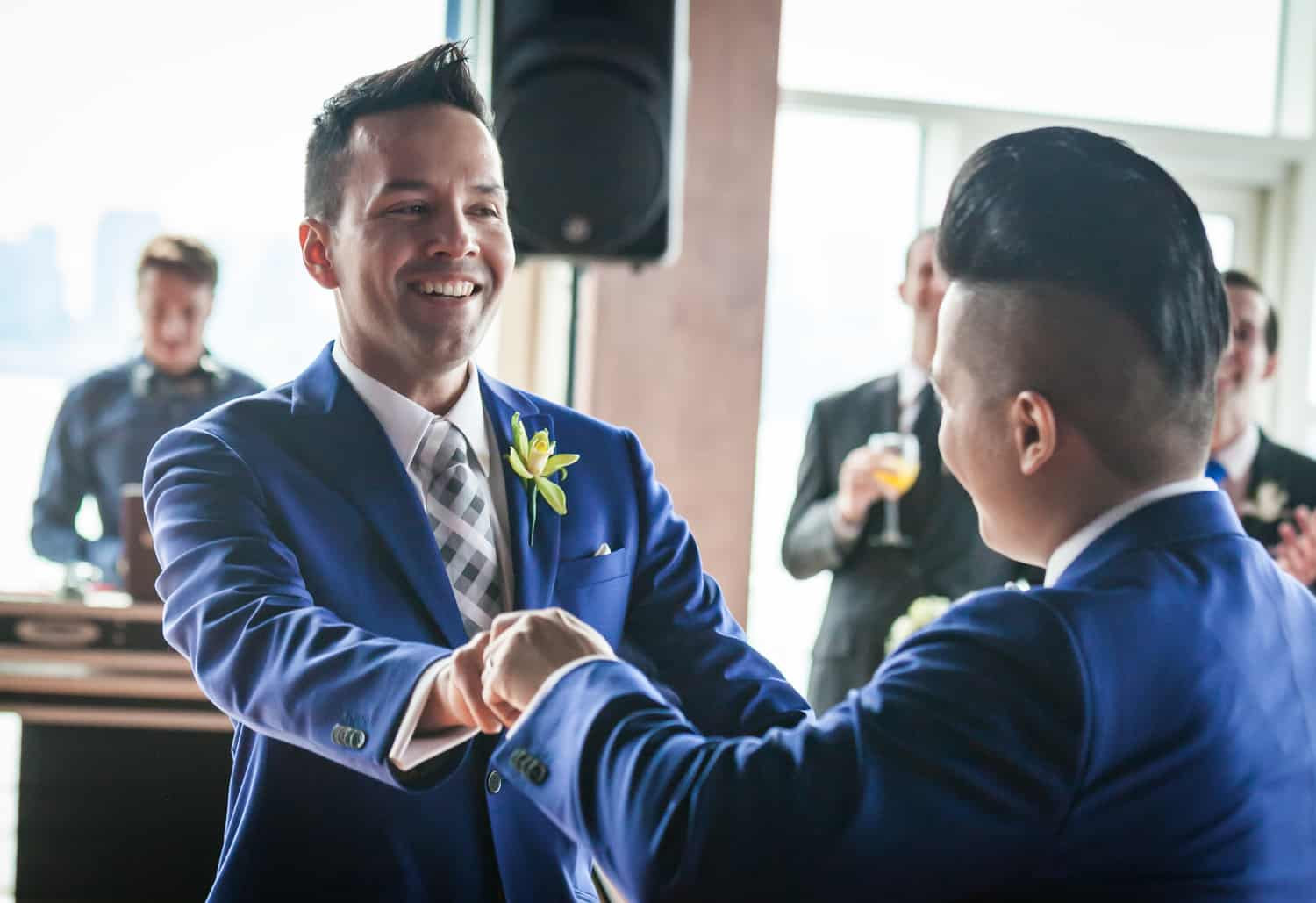 Two grooms dancing at a Lighthouse at Chelsea Piers wedding