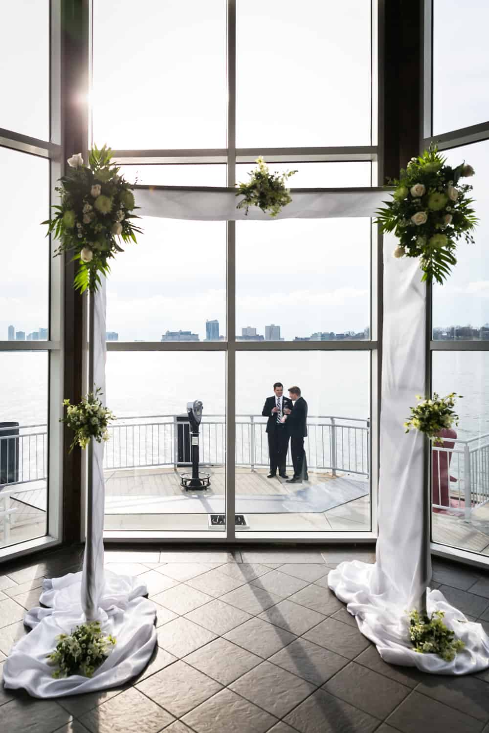 View of Hudson River and two guests outside through altar