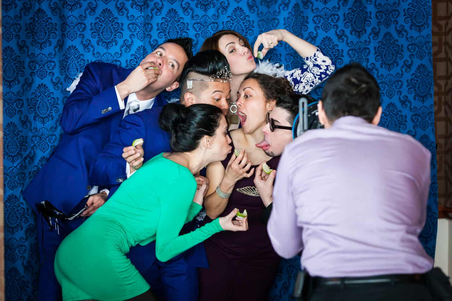 Guests clowning around at photobooth at a Lighthouse at Chelsea Piers wedding