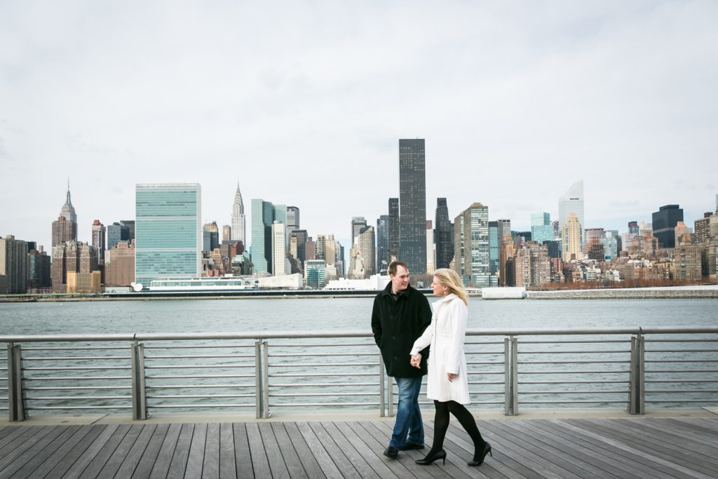 Bride and groom walking in Gantry Plaza State Park at a Long Island City wedding brunch