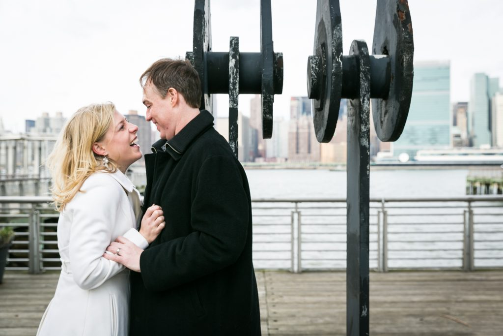 Couple in front of industrial columns in Gantry Plaza State Park