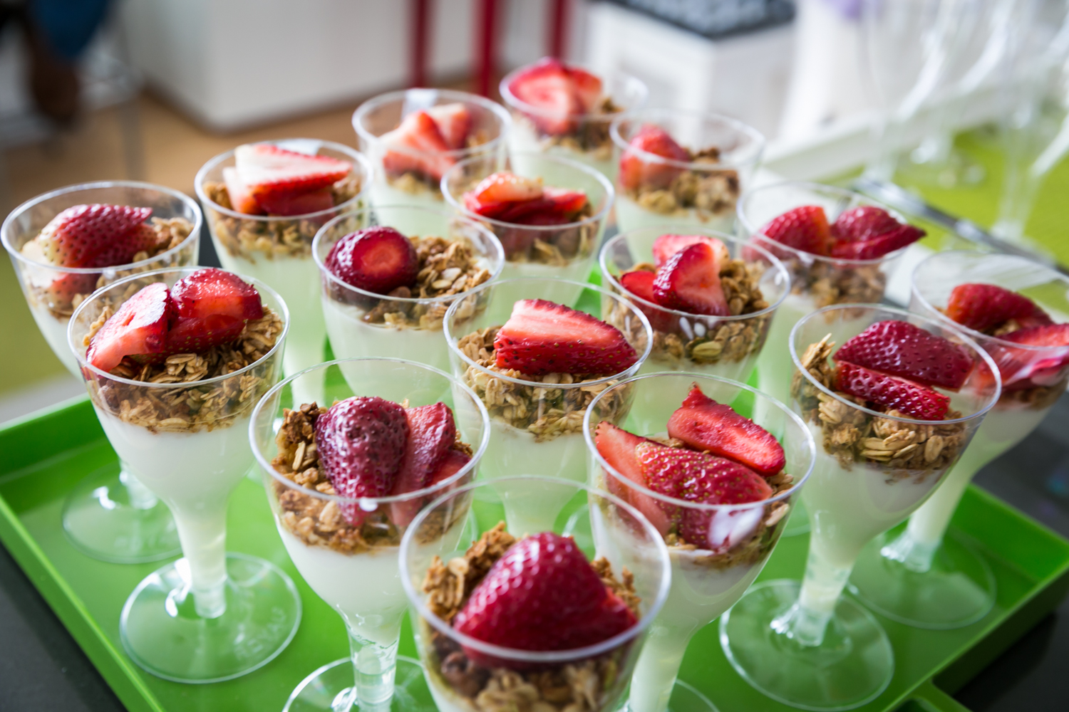 Wine glasses filled with yogurt and strawberries at a Long Island City wedding brunch