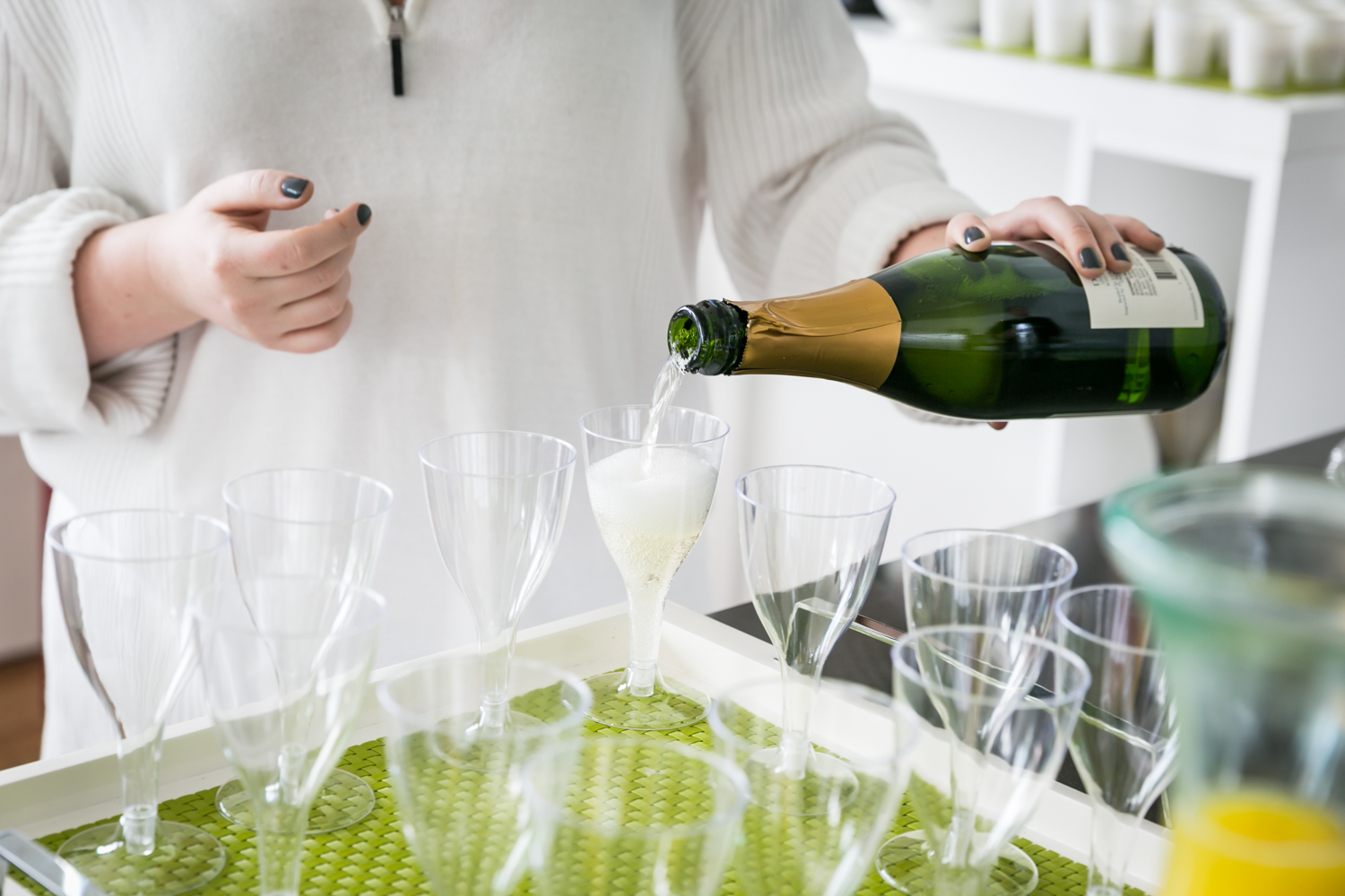 Close up of woman pouring champagne