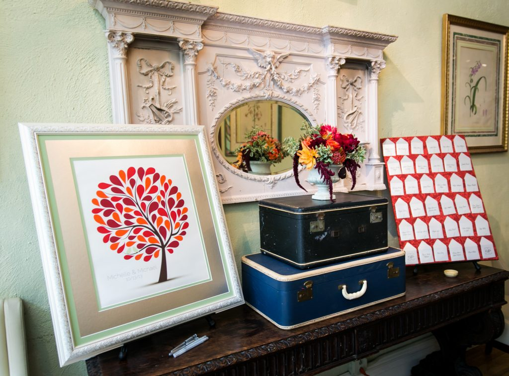 Display of guest book and suitcases, and escort cards