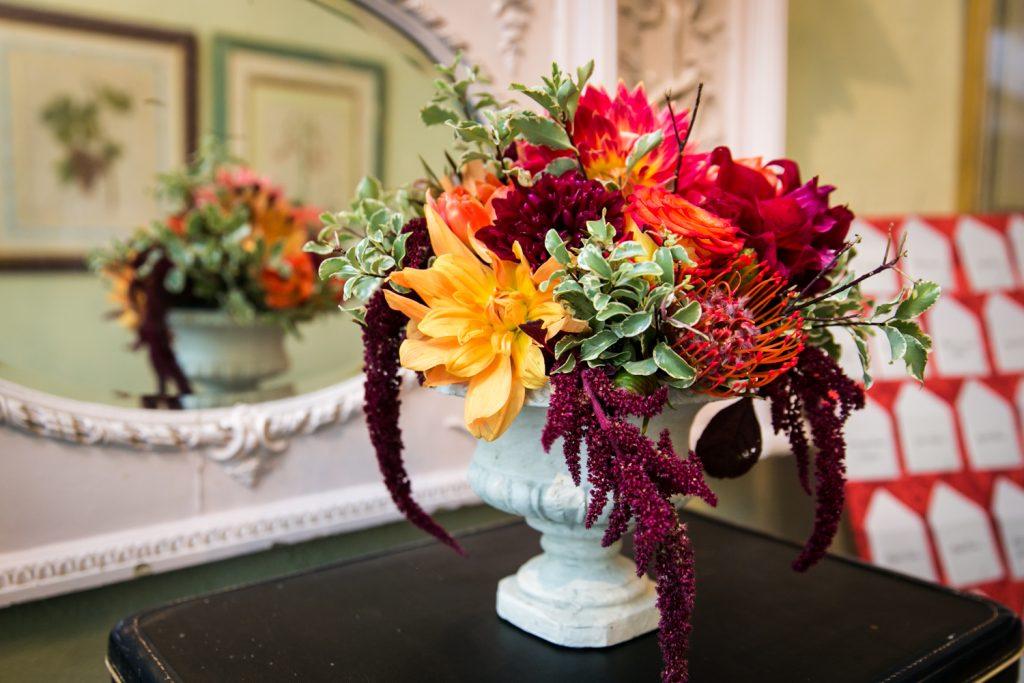 Vase full of orange and yellow flowers