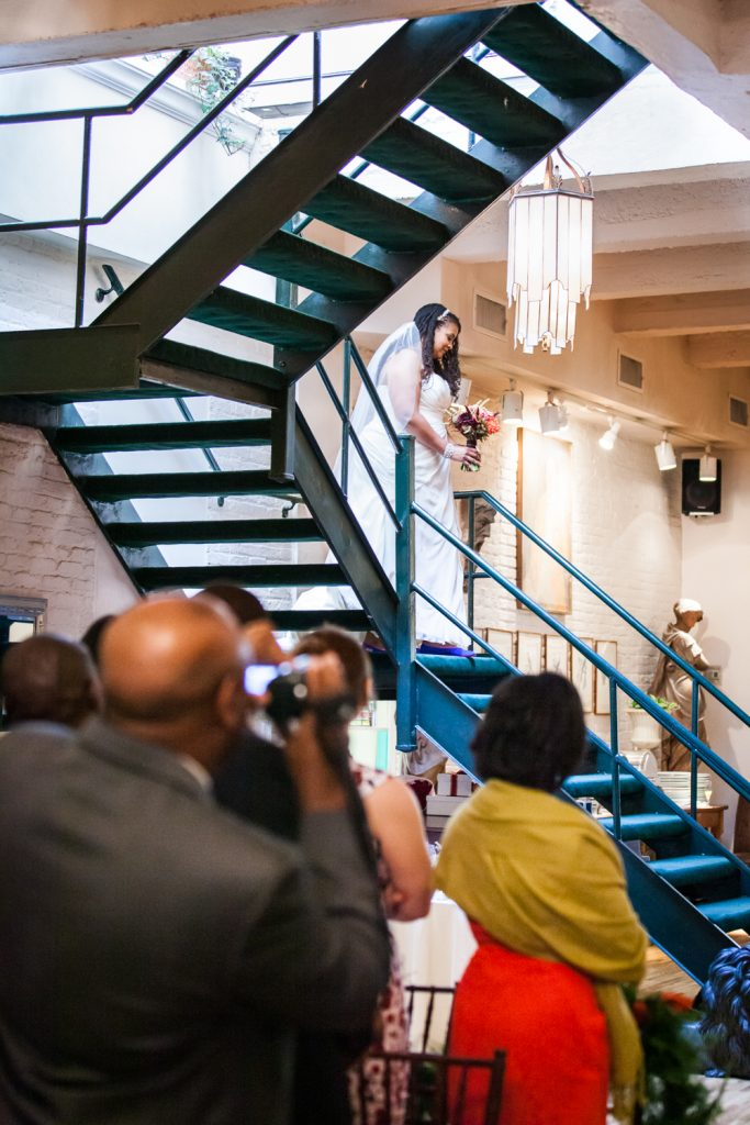 Alger House wedding portraits of bride coming down stairs for ceremony