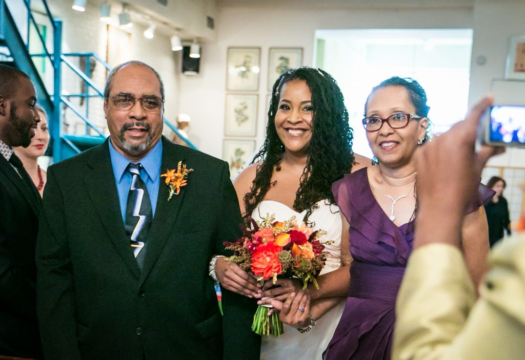Alger House wedding portraits of bride and both parents walking down aisle
