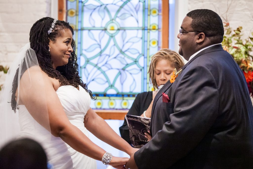 Alger House wedding portraits of bride and groom exchanging vows