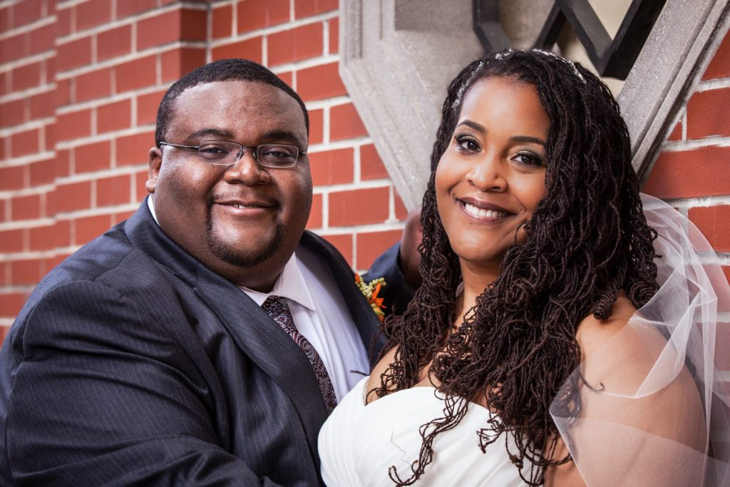 Alger House wedding portraits of bride and groom in front of brick wall