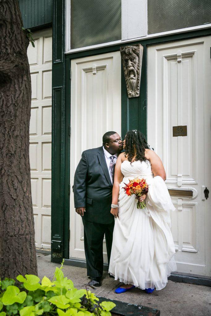 Alger House wedding portraits of bride and groom outside entrance to Alger House