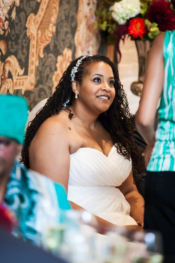 Alger House wedding portraits of bride sitting and listening to guest