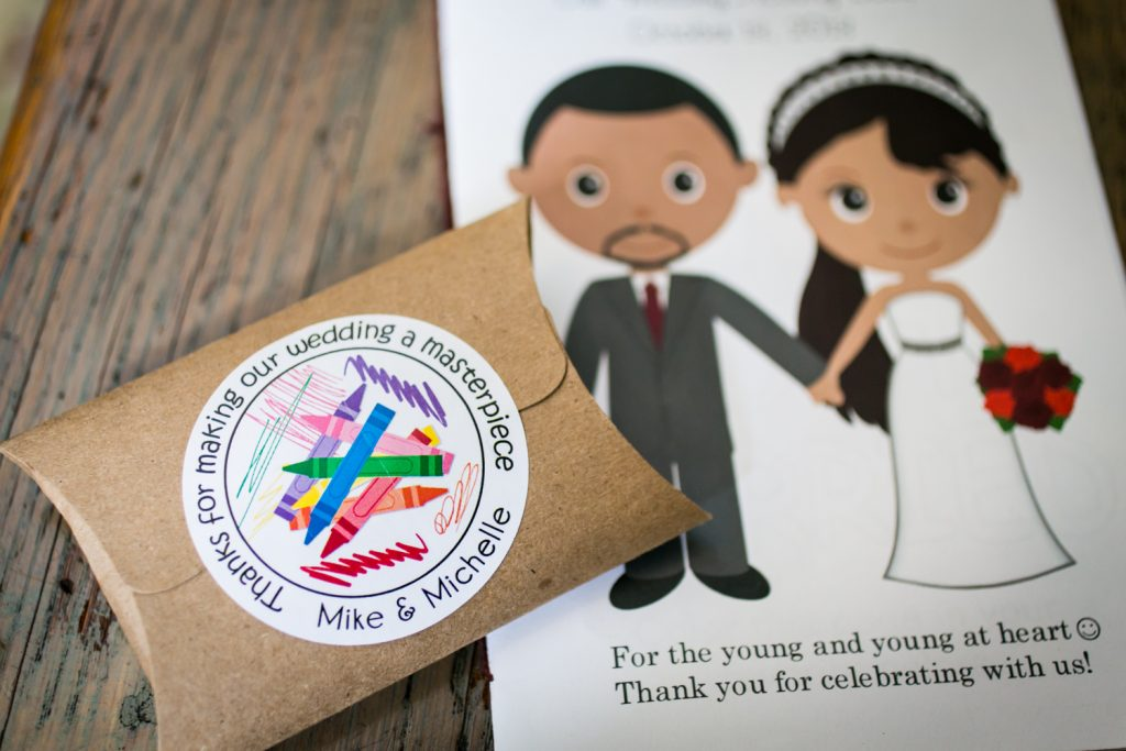 Close up on packet of crayons and wedding activity book