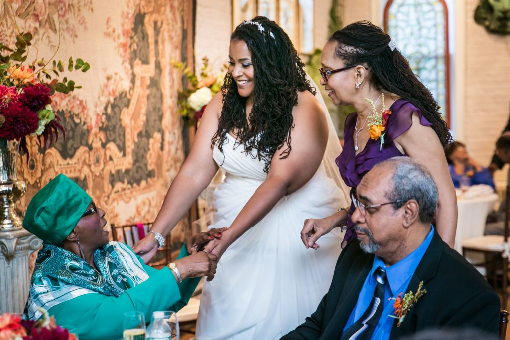 Alger House wedding portraits of bride greeting older woman at table
