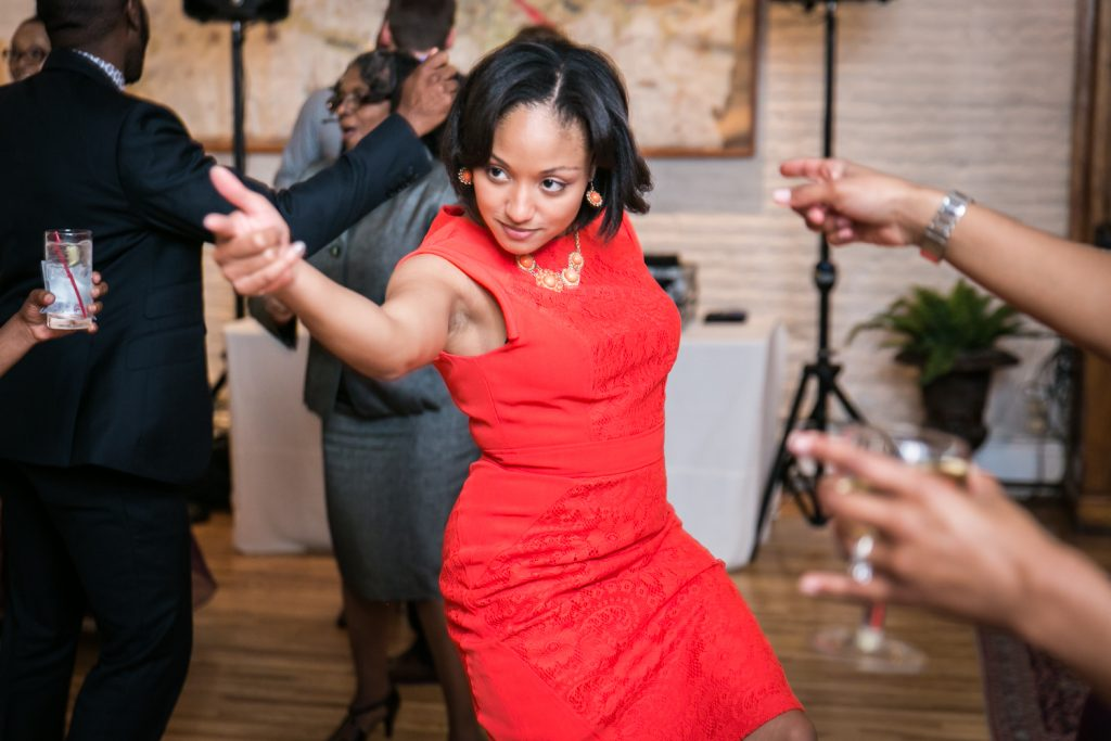 Alger House wedding portraits of female guest wearing red dress dancing