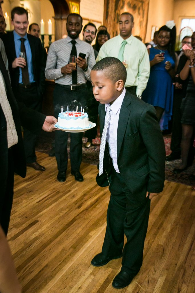 Alger House wedding portraits of young boy blowing out birthday cake