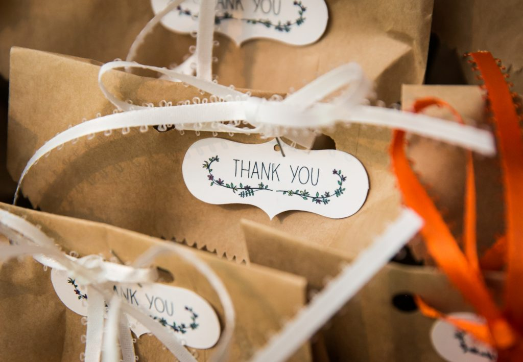 Close up on brown paper bags with 'thank you' tags