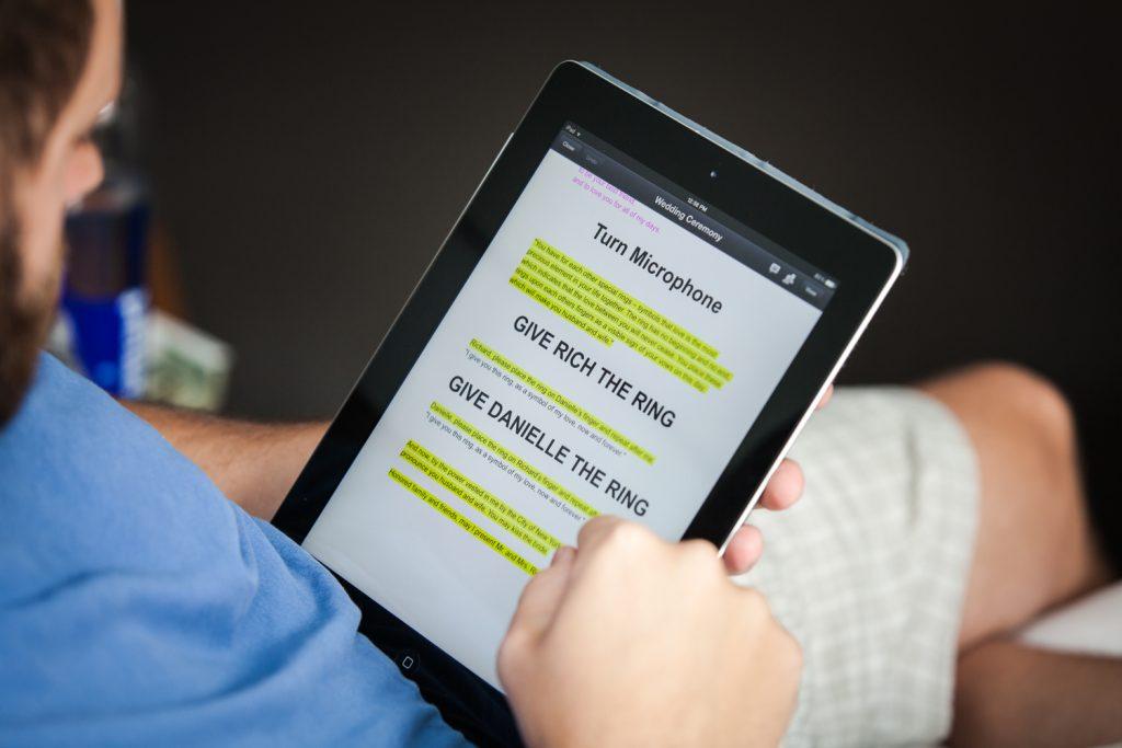 Close up on iPad of wedding ceremony script