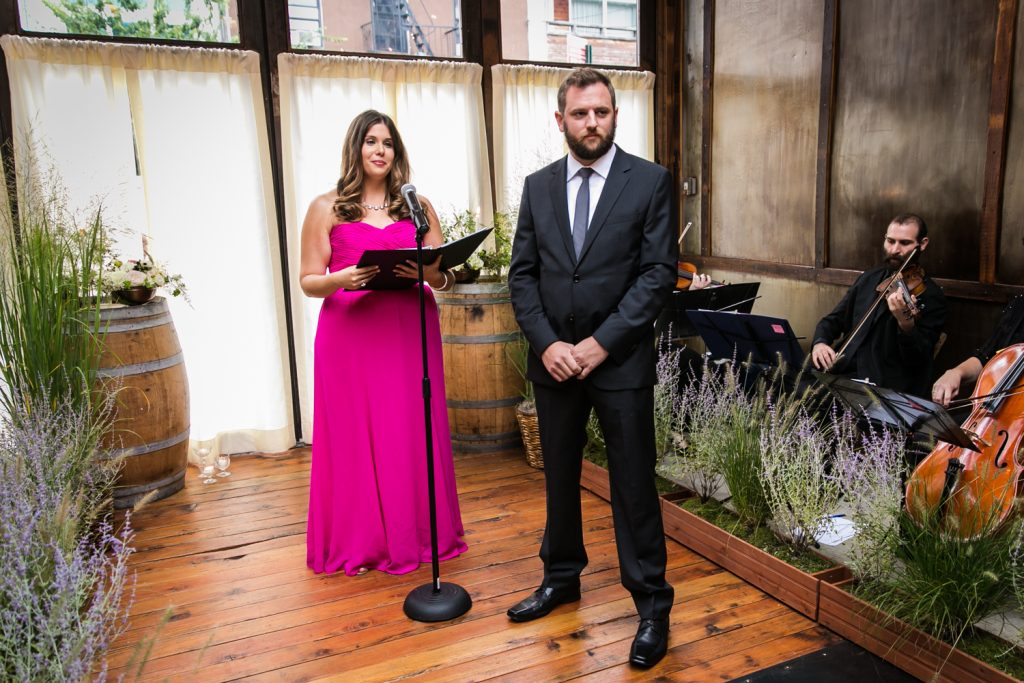 Groom and officiant waiting for bride to arrive at a Brooklyn Winery wedding