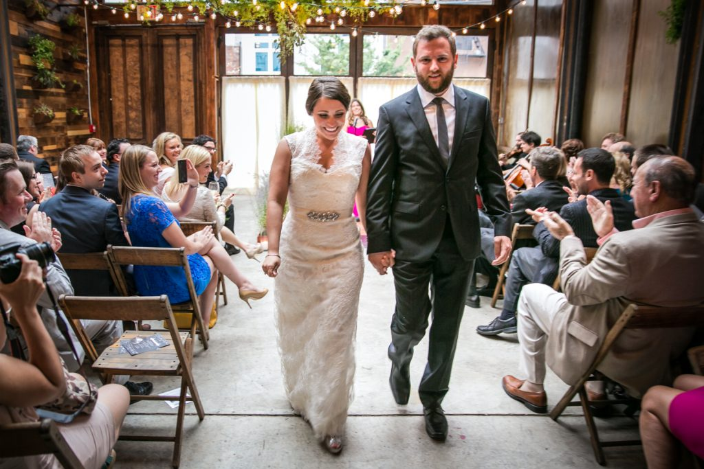 Bride and groom walking down aisle after ceremony at a Brooklyn Winery wedding