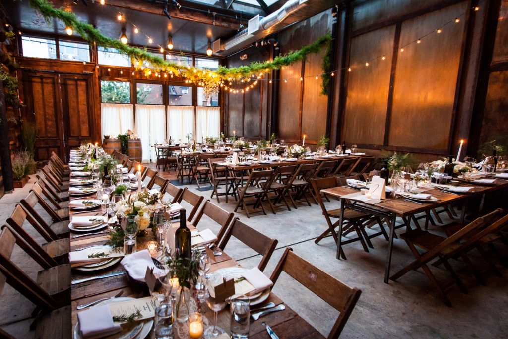 Wide shot of tables and place settings at a Brooklyn Winery wedding