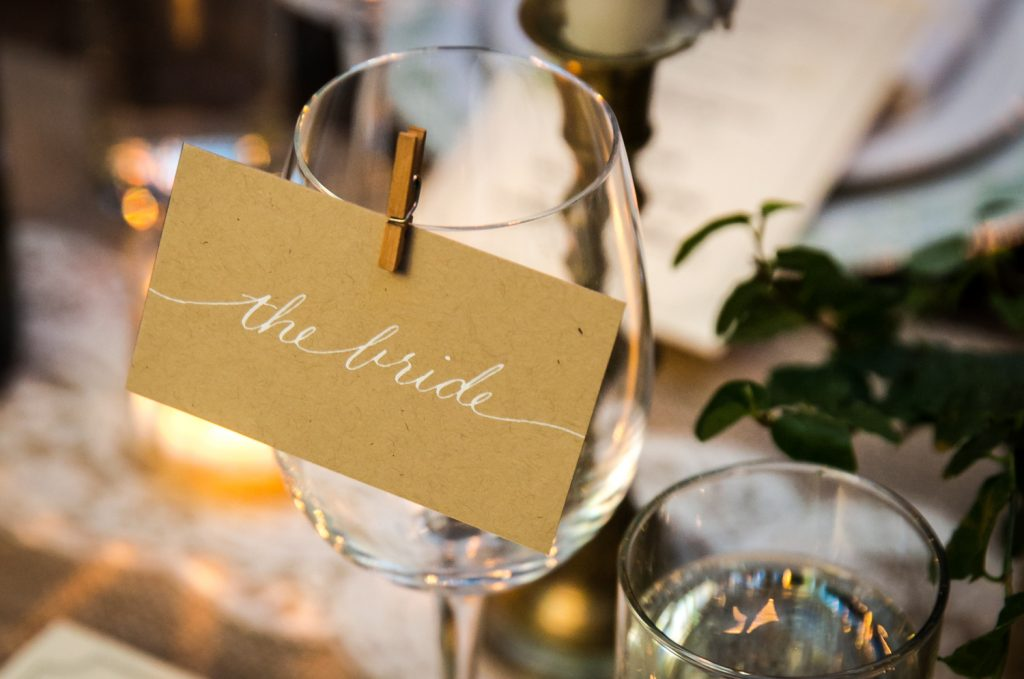 Close up on wine glass with 'the bride' sign at a Brooklyn Winery wedding
