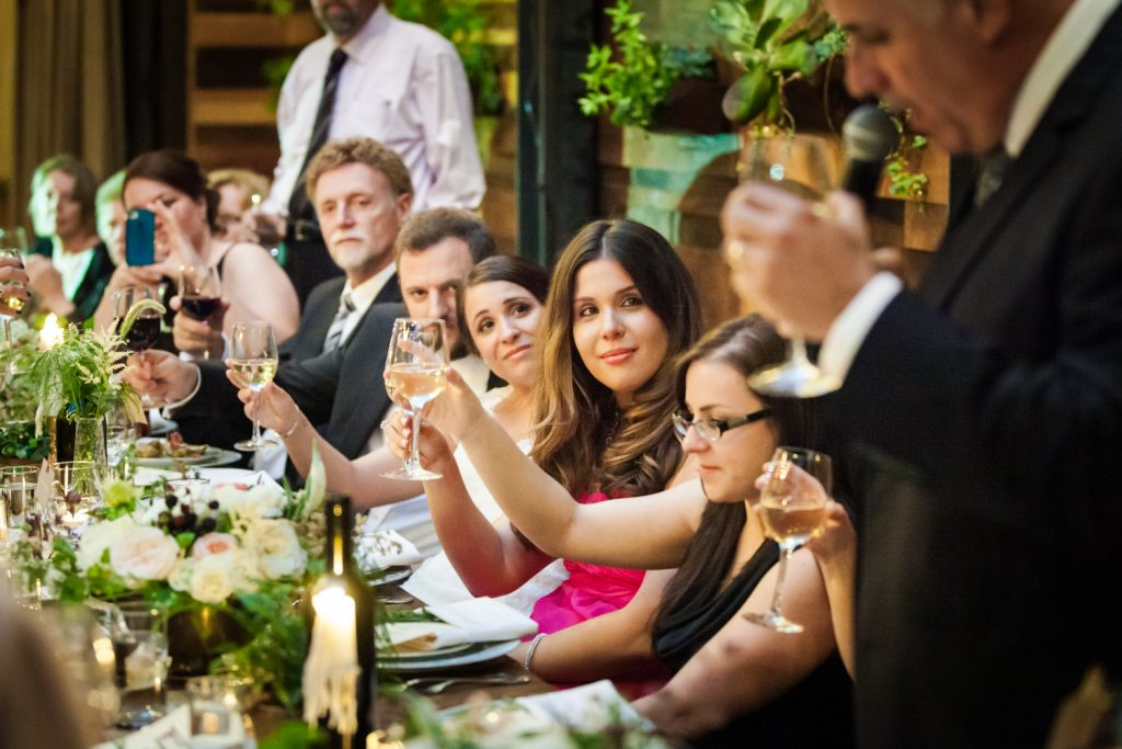 Bridal party toasting speaker at a Brooklyn Winery wedding
