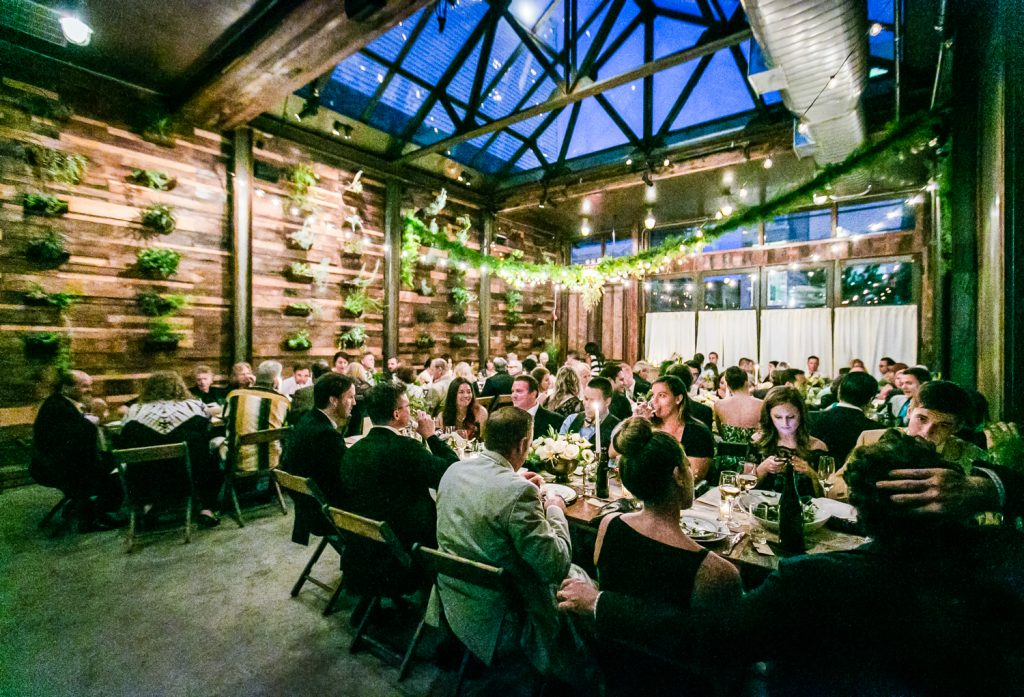 Wide shot of guests seated during reception at a Brooklyn Winery wedding