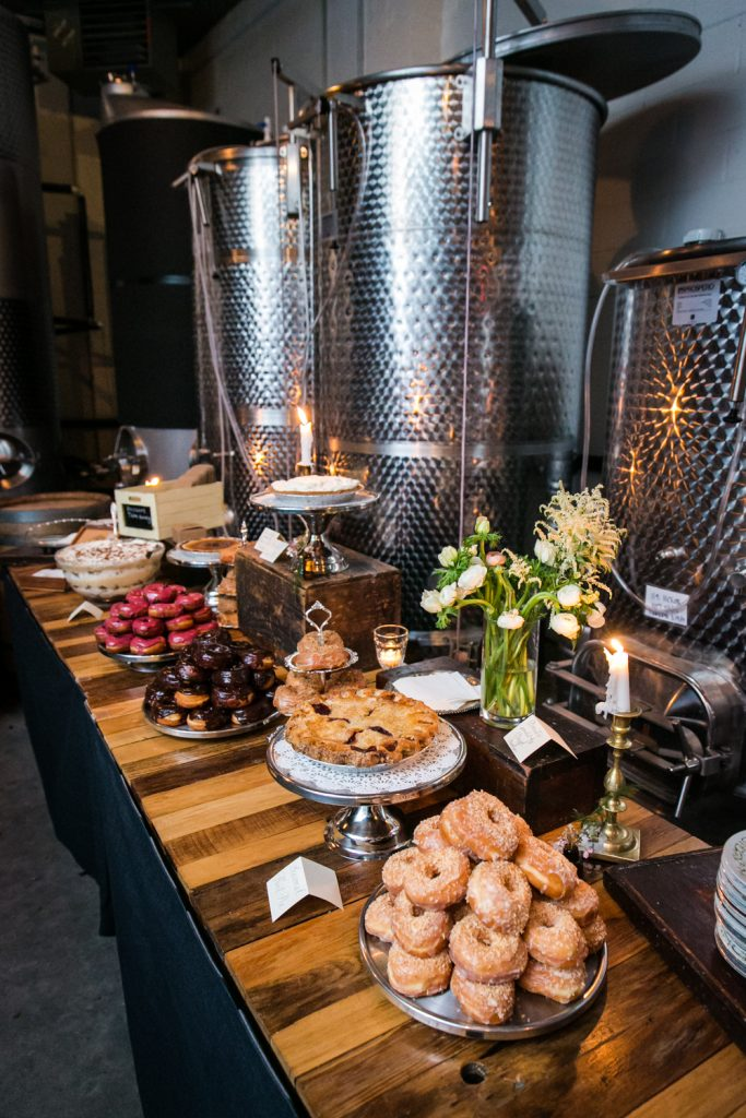 Dessert buffet with doughnuts and pie at a Brooklyn Winery wedding