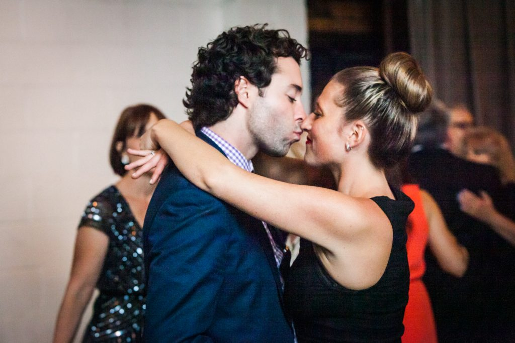 Couple kissing on dance floor at a Brooklyn Winery wedding