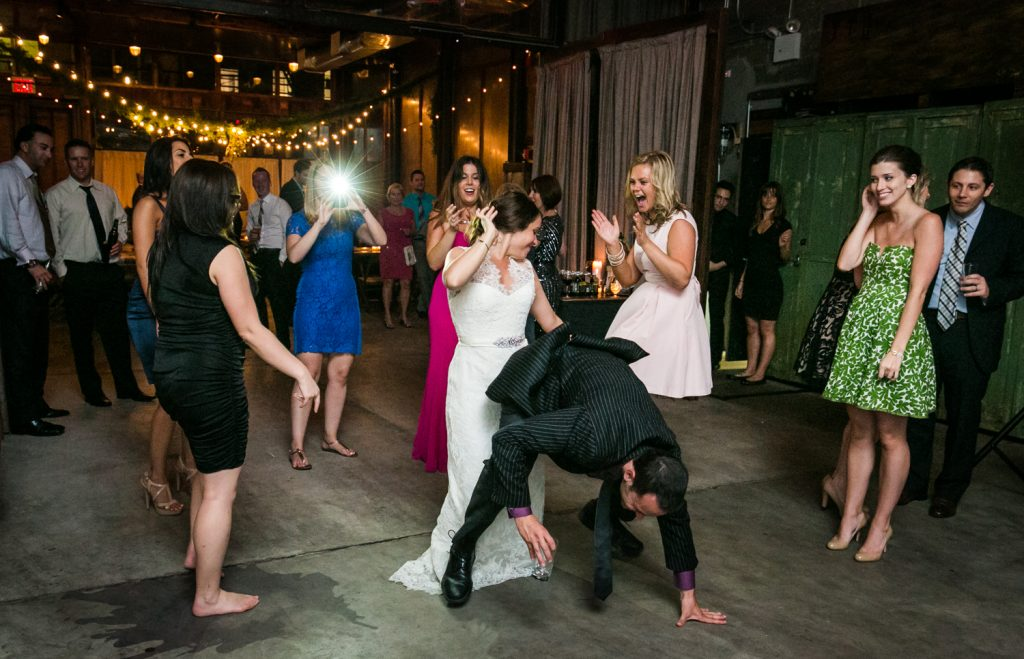 Bride dancing wildly with guests at a Brooklyn Winery wedding