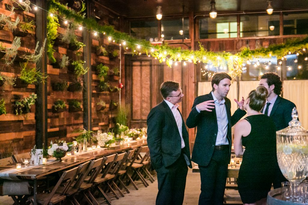 Four guests talking during a Brooklyn Winery wedding reception