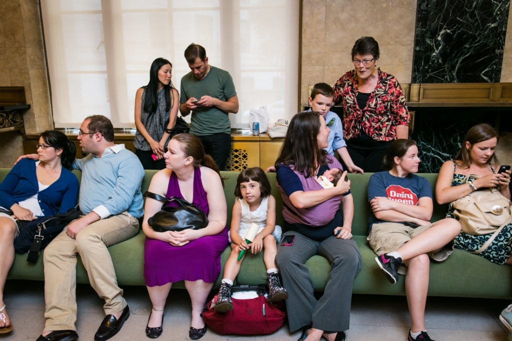 People sitting on couch waiting for a NYC LGBTQ City Hall wedding to begin