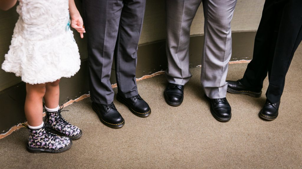 Close up of family wearing matching Doc Martens before a NYC LGBTQ City Hall wedding