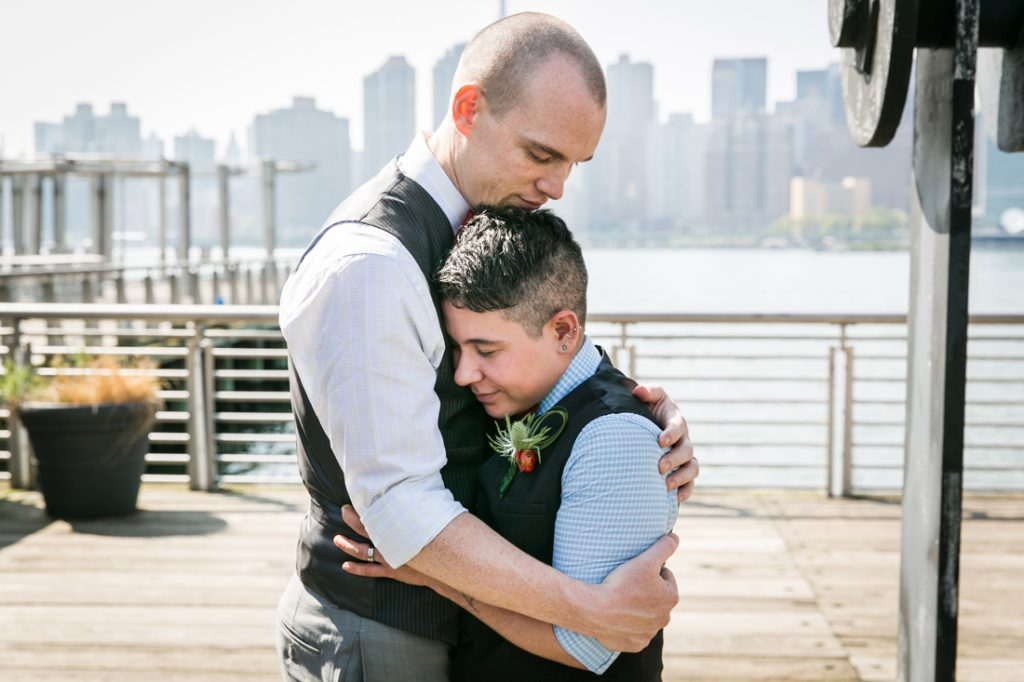 Two grooms hugging at Gantry Plaza State Park