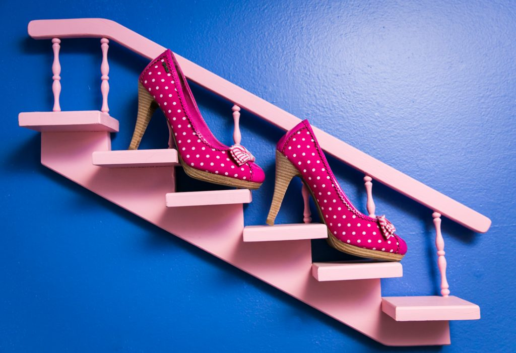 Bride's pink polka dot high heels on pink mini staircase