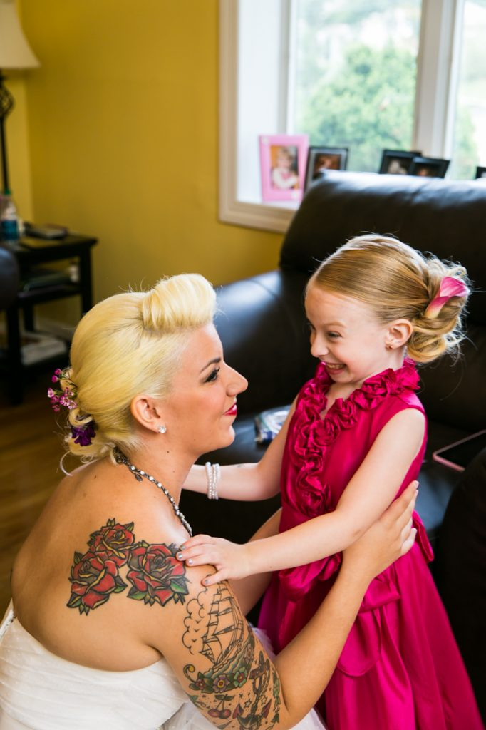 Bride talking to little flower girl before a Riviera Waterfront Mansion wedding