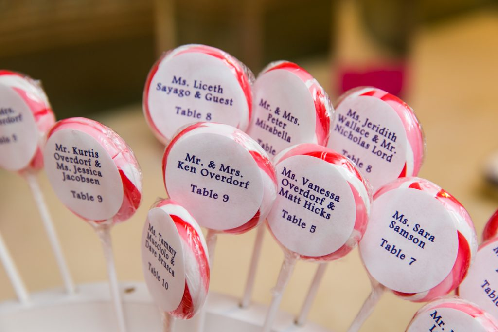 Lollipops with seating assignments at Riviera Waterfront Mansion wedding