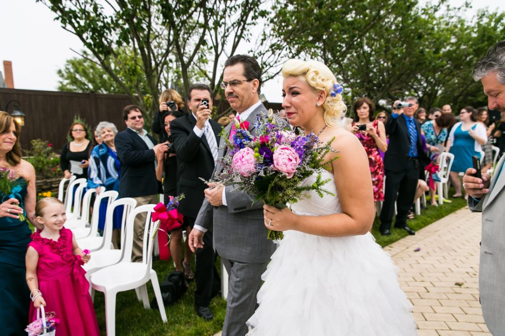 Bride and father walking down aisle at Riviera Waterfront Mansion wedding