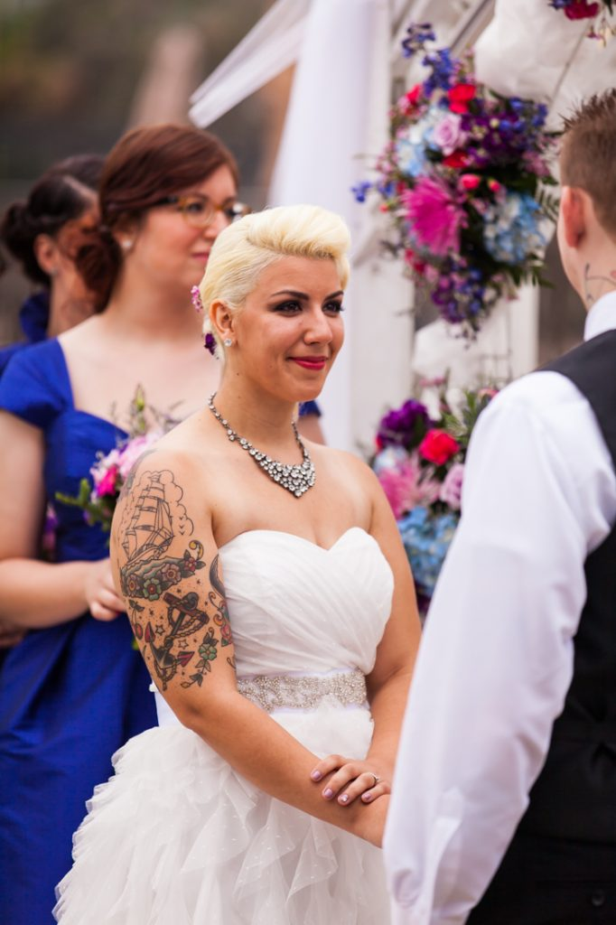 Bride looking at groom during ceremony at Riviera Waterfront Mansion wedding