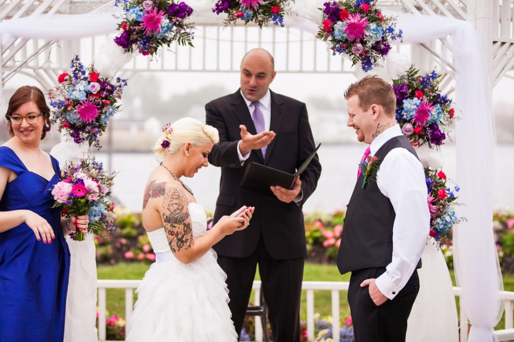 Bride and groom exchanging vows at Riviera Waterfront Mansion wedding