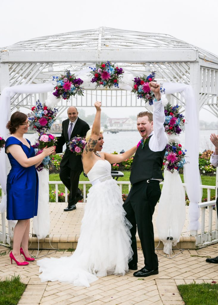 Bride and groom pumping fists after ceremony at Riviera Waterfront Mansion wedding